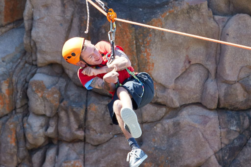 Image of Tom Dow abseiling
